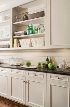 Gorgeous butler's pantry features open shelving over creamy white cabinets toppe. Gorgeous butler's pantry features open shelving over creamy white cabinets topped with black countertops and paired with tongue and groove backsplash. Kitchen Redo, Kitchen Backsplash, New Kitchen, Kitchen Remodel, Kitchen Dining, Kitchen Cabinets, White Cabinets, Wall Cabinets, Shaker Cabinets
