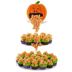 Halloween Surprise Cake and Cupcakes  - This creepy, tongue-in-cheek Halloween treatscape features a jack-o'-lantern cake, brightly colored cupcakes and popcorn extras will delight all your guests. Use the Wilton Dimensions Pumpkin Pan to make the cake and Wilton Orange Candy Melts Candy for the popcorn mixture.