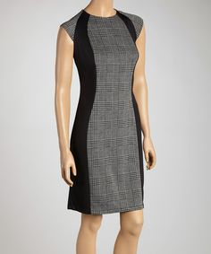 Execute an exquisite ensemble in this sleek sheath dress. The classic silhouette showcases refined style while flattering an hourglass figure and a classic plaid print accentuates great, fashionable taste. Measurements (size 8): 39'' long from high point of shoulder to hemBody: 98% polyester / 2% spandexCombo: 75% poly...