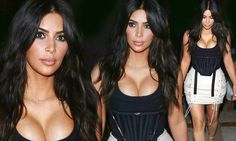 Kim Kardashian models risque-looking garter top with lace up miniskirt | Daily Mail Online