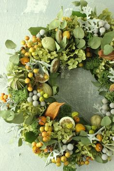 Stunning grays and dusty greens with citrus colored accents wreath for fall and winter
