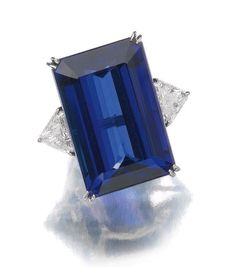 Ring of Stiep-cut Tanzanite (64 carats) and triangular shaped Diamonds. (=)