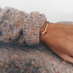 Under the cuff / Celine knot bracelet and delicate bracelets poke out from a cozy fall sweater Jewelry Box, Jewelry Accessories, Fashion Accessories, Jewlery, Gold Jewelry, Jewelry Rings, Vintage Jewelry, Fashion Jewelry, Eye Jewelry