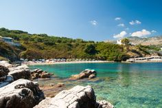 The very special and secluded beach Kanoni Kassiopis has large smooth rocks and a small part with sand over the blue waters. https://greece.terrabook.com/corfu/page/kanoni-beach-kassiopi  #Greece #Corfu #terrabook #GreekIslands #TravelTips #Travel #GreeceTravel #GreekPhotos #Traveling #Travelling #Holiday #Summer