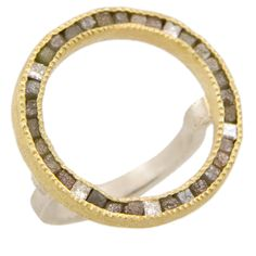 Silver, 18ky gold, 2mm raw diamond cubes (3ctw.), five 2mm Princess cut diamonds (.35ctw.), channel set in a large circle. Hand forged and fabricated