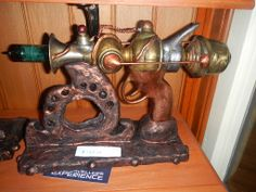 Raygun made from Resin, metal parts and custom made stands for sale at Timetravellers
