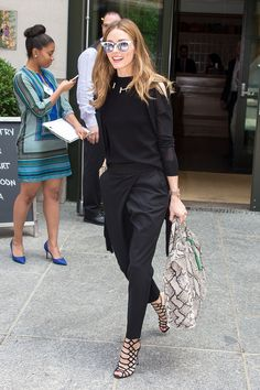 Who: Olivia Palermo What: Strappy, Sexy Shoes Why: The girl-about-town is bringing all-black back in avant-garde trousers and a sheer-arm sweater, punctuated by ultra-sexy black heel by Schutz. Get the look now: Schutz shoes, $190, schutz-shoes.com.   - HarpersBAZAAR.com