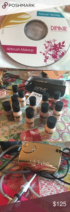 Dinair airbrush makeup set New never used there is 12 makeup colors 2 spray guns and the CD gave over $300 for it and the box it came in got torn up when I moved. Dinair Makeup Brushes & Tools