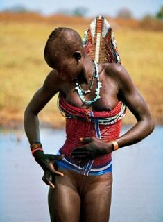 Dinka Woman in Corset, South Sudan, Africa.| Photograph by Carol Beckwith-Angela Fisher. #Dinka #corset #beadwork