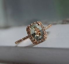 Cushion jasmine green/champagne sapphire with a rose gold diamond set ring.