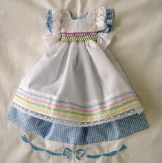 One of many sweet dresses for a one of a kind quilt.  Visit the site to see them all!!