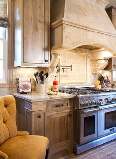 Stone details also help bring an English country vibe to interiors. Add a touch of stone to the kitchen with a travertine hood like this one.