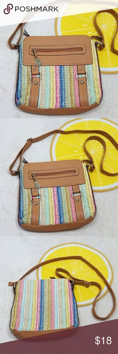 "Rosetti Colorful Woven Faux Leather Crossbody Bag -Excellent like new condition- some wear/fraying on top corners (see pic 6) -Three main compartments (one zip shut), a few small inside pockets, and an outer pocket Please note measurements for size comparisons: -W 9.5"" -L 10.5"" -D 1"" -Strap 23.5"", adjustable  -Faux leather and plastic woven canvas (no material tag) -Pink, green, blue, yellow pastels and tan (colors' appearance may vary on screen)  Questions? Just ask! Bundle to save!  Offers…"