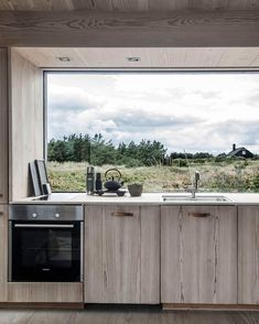 A contemporary weekend home in Skagen, Denmark with a modern rustic interior. A contemporary weekend home in Skagen, Denmark with a modern rustic interior.