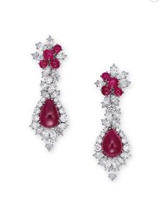 A PAIR OF RUBY AND DIAMOND EAR PENDANTS, BY HARRY WINSTON. Each set with a pear-shaped cabochon ruby, within a brilliant and marquise-cut diamond foliate surround, extending to the surmount accented further by cabochon rubies, mounted in platinum and 18k white gold, 6.3 cm long, in black leather Harry Winston case. With maker's mark for Harry Winston. (2)