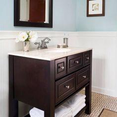 I like this simple vanity in dark wood.