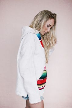 Handcrafted Baja Hoodies! Keep cozy is our most comforting cover up yet. This hoodie, accented with found mexican blankets is warm for fall beach trips or winter lounging. Organic cotton fabric is lin