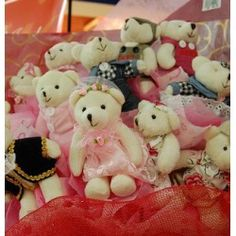 12 Teddy's in a bunch wrapped with gift wrapping.Teddy's would be 3 inch height. http://thetradeboss.com/deals_detail.php?id=68