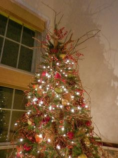 nature inspired christmas decorating finally the crowning tree topper is a pair of naturally sheddeer