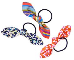 Bow Hair Tie using 5x5 fabric, sewn in an oval, then tied in a knot on an elastic hair band...simple and inexpensive to include in the shoeboxes for girls (don't forget the brush and/or comb, too)