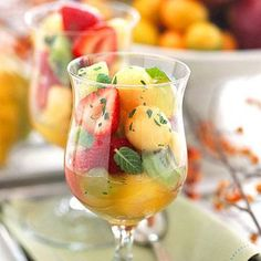 Honey Rum Fruit Salad - A dressing of mint, lime juice, rum, and honey bathes the fresh fruits with festive flavor. Potluck Recipes, Side Dish Recipes, Cooking Recipes, Cooking Stuff, Fresh Fruit Salad, Fruit Salad Recipes, Fruit Dishes, Food Dishes, Fruit Cups
