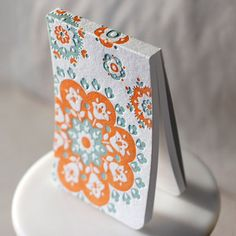 Cover a notebook with letterpress stock - maybe add seal with monogram...