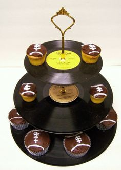 Recycled record cupcake stand, i love this idea, just not football cupcakes, maybe guitar picks
