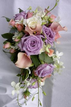 Cascading teardrop stylized bridal bouquet of lavender and white Roses, mauve mini Calla Lilies, pink spray Roses and Dendrobium Orchids