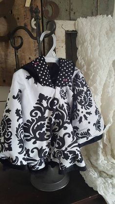 "Infant/Toddler Girls ""ArRee"" Poncho Cloak, black and white fleur-de-lis de lis  pattern with pink accents"