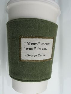 Meow means woof in cat  George Carlin  Coffee Cozy by CreamNoSugar, $9.50
