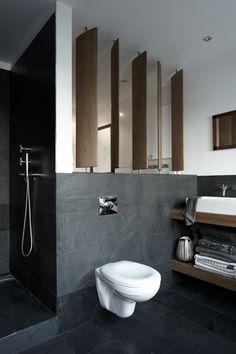 Dan Faires (www.danielgradyfaires.com) wood louver idea to replace the granite bookcase under stairs