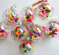 Personalised Christmas bauble- Colourful modern font hand painted with pom poms. by SummerSvenson on Etsy https://www.etsy.com/listing/167628366/personalised-christmas-bauble-colourful