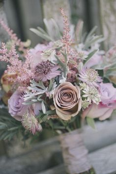 Bouquet using a selection of different grey foliages and dusky pink flowers.