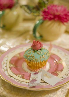 Wedding table centre piece, vintage plates, zoe clark cupcake