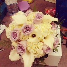 Purple roses, white cala lilies, white hydrangea