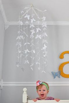 How cool would these be to have these hanging one from over Zoey's bed? Maybe rainbow colored butterflies...or pink/zebra lol