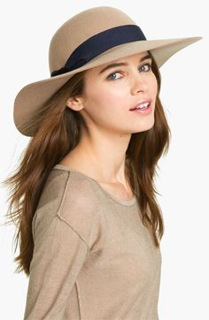 "A grosgrain band rings the crown of a wool felt hat shaped with a wide, sloping brim.Blk or Carmel 88. US free shipping & returns  Approx. brim width: 4"".  Approx. inner circumference22"".  Wool; spot clean.By Genie by Eugenia Kim; imported."
