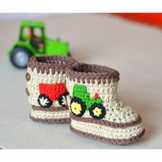 These cute little tractor booties are very easy to crochet - what little boy doesn't love tractors - these will be like a magnet to other children so a very cool way for your little one to make friends!The pattern is easy to follow with 10 pages including color photos throughout to guide you through the entire process no need to be an expert crocheter! The tractor and trailer are appliqued on after the booties are finished. I used embroidery thread doubled as I really wanted the true colors…