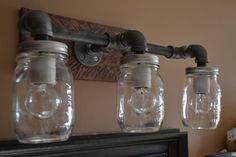 A unique statement piece for your home to add style to any space that you please. Featuring an almost steampunk look of industrial piping and pallet wood to create a rustic look that you are looking for. Features 500ml Bernardin mason jars. All lighting sockets will accept the medium base Incandescent , CFL and LED Bulbs. Installation by a qualified electrician is always recommended Item Details Dimensions: 18W x 8D x 9H Lights are wired for 120V 60Hz Recommended lighting is three 40 watt…