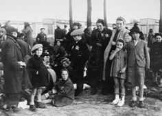 The End is Near. A group of Jewish women and children selected for Death wait to be led to the Gas Chambers at Auschwitz / Birkenau. What fearsome enemies of the Reich they must have been to be treated so.