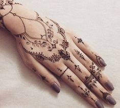 Henna Mehndi hand and finger tattoo design