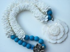 White and Teal, Tropical, Carved Shell Pendant, Bead Crochet Necklace. $70.00, via Etsy.
