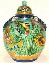 "Talavera Pottery . $92.00. Talavera round loop ribboned handled tibor pot our largest. Very attractive and will make fill that special spot in your home. Hand made and hand painted expect slight design variations.Height 19 1/2""Width 15 1/2"" Model 80550-F Fish Design"