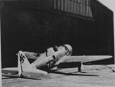 """Captured American P-47 Thunderbolt """"razorback"""" found at a Luftwaffe base in Germany - fueled and armed."""