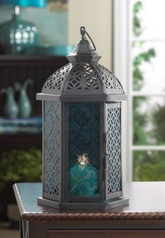 10016070 - Blue Cove Candle Lantern - Wholesale. Moroccan lanterns for weddings or for home decorations.  Individual or buy in bulk. https://superwholesaler.com