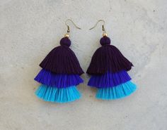 These are a hand-crafted pair of earrings that have been made from cotton yarn and brass beads.  They will look great with your favorite pairs of jeans, shorts or a night out dress!  Length 3.5