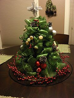 Mesh Christmas Tree DIY (this is the link to this cute tree ~ I'm thinking great gift idea)  http://sewfantastic.blogspot.com/search?q=mesh+christmas+tree