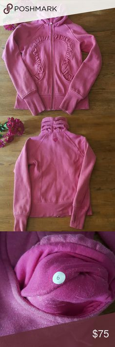Lululemon sparkle pink cuddle up jacket Stylish and warm! This zip up sweatshirt is so comfortable and features a perfectly flattering pink with subtle silver sparkles.  Gently worn and washed and air dried. Size tag has been cut but has size listed in pocket. Lululemon  Tops Sweatshirts & Hoodies