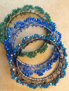 Peacock Bangles: Beadalon's Artistic Wire in 32 gauge delicately hand-crocheted with Swarovski crystals, along flat memory wire.