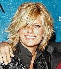 Patti Hansen, at 55, uses layers, whispy bangs, and a side part to hide her thinning hair.